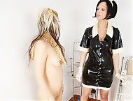 Head nurse prepares the crazy patient in the rubber psychiatry for the night attracting a very special latex catsuit