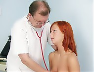 Claudia forced by gyno practitioner to lick her breasts and open her puss wide